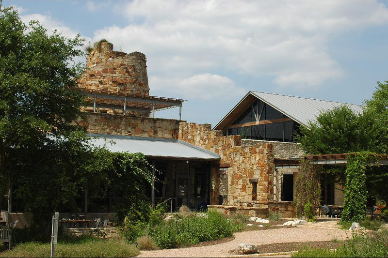 Some native Texas limestone in the buildings as well.
