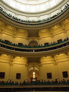 Christian school group poses for photo on three floors of the Capitol rotunda.