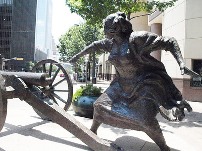 Local heroine Angelina Eberly stopped the illegal move of the new republic's capital to Houston in 1842. Statue by Pat Oliphant.