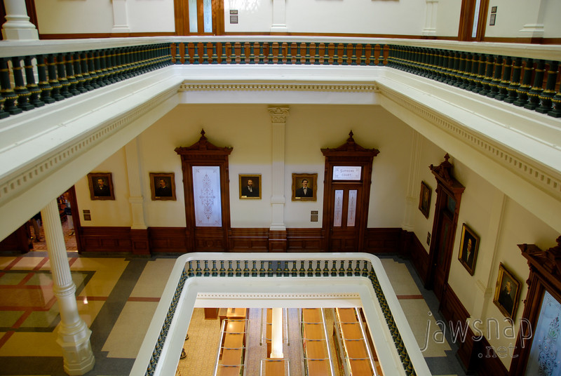 """<span id=""""title"""">Levels</span> I like the green columns on the banisters throughout the building. This shot was taken on the 2nd level and looks down into the library on the lower level."""