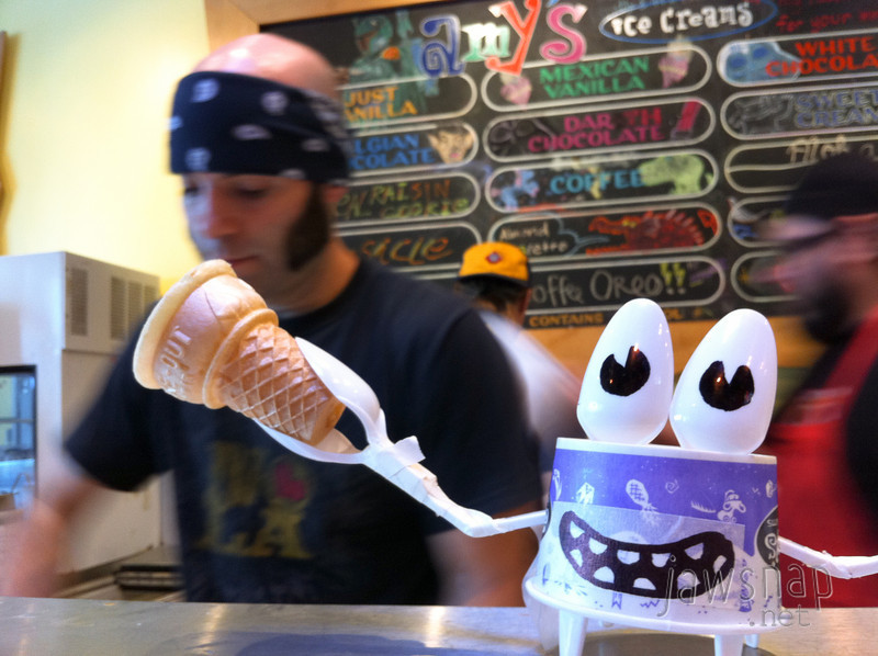 """<span id=""""title"""">Amy's Ice Cream</span> This cone-holding crab thing was on the counter at Amy's Ice Cream. They have fun flavors, some with alcohol, and the ice cream makers do fun tricks like throwing the ice cream behind their back and catching it in a bowl. I'd like to see the teenagers at Cold Stone pull that off.  I got a bloody sword that had vanilla and pralines. The guy asked if I knew why it was called a bloody sword and I said I didn't know. He said he didn't, either."""