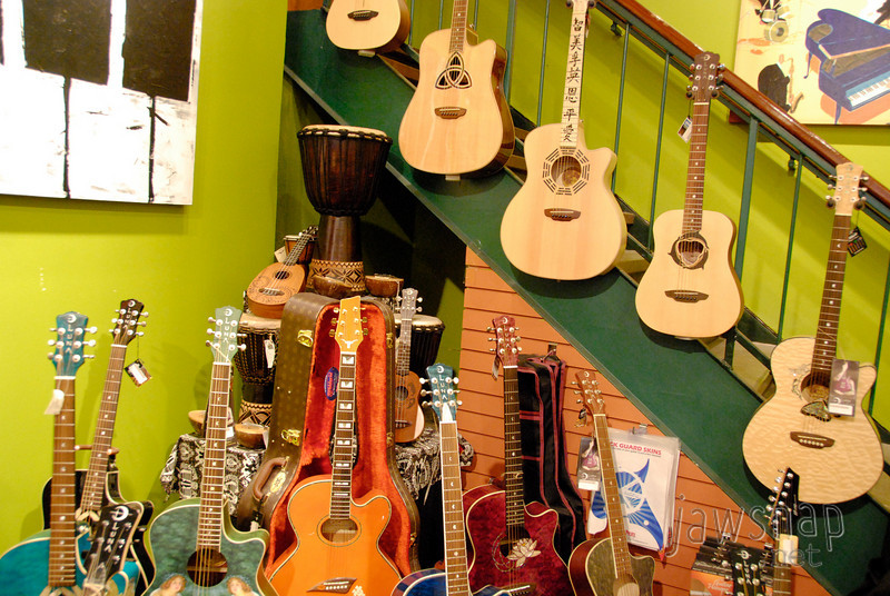 """<span id=""""title"""">Gee Tars</span> Cool guitars in a music shop on 6th street. I don't think I was supposed to take photos, but here's some free advertising. HEY EVERYBODY, VISIT <a href=""""http://www.wildaboutmusic.com/"""">WILD ABOUT MUSIC</a> IF YOU'RE IN AUSTIN! They had some really cool stuff here, seriously."""