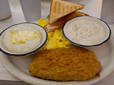 Chicken Fried Steak with Grits, Eggs and Gravy