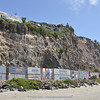 shipping containers to protect the road from falling rocks