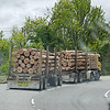 Tandem log truck. Forestry is a major business in New Zealand.