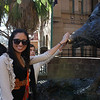 Grace petting the wild boar's nose for luck.