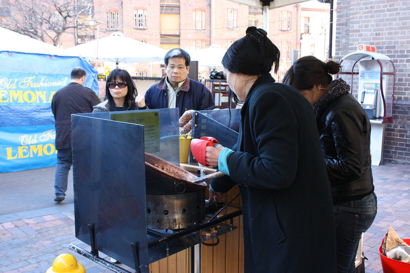 Woman cooking at the market.