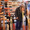 A guy playing the didgeridoo at the market.
