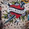 Dev and Chris by Hosier Lane street art.
