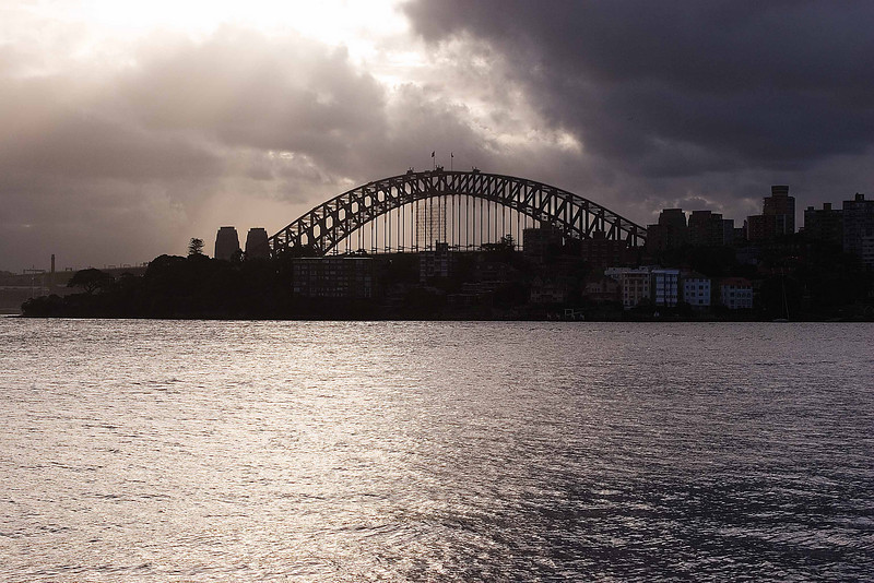Sydney Harbour Bridge from Neutral Bay. These dark clouds in front and blue sky behind us.