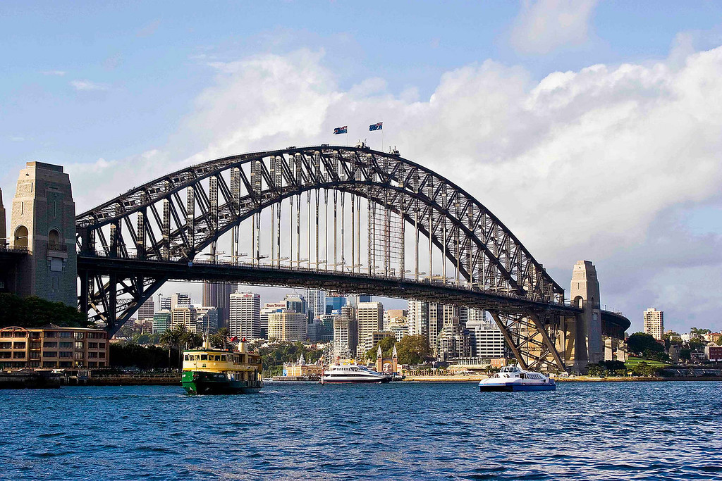 Sydney Harbour Bridge from Circular Quay.  If you look close, you can see people hiking to the top of the bridge.  The price is $160 AU.  The two flags are the New South Wales and the Australian
