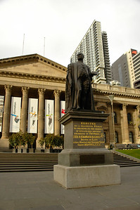 Statue of Sir Redmond Barry, Doctor of Laws at the State Library of Victoria. Melbourne, Victoria (VIC), Australia.