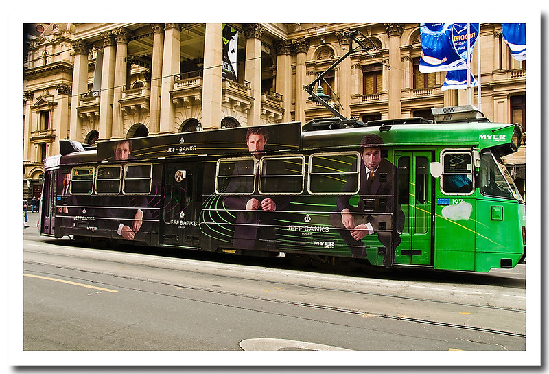 Tram with advertising mural painted on the side of tram, Melbourne,Victoria, Australia