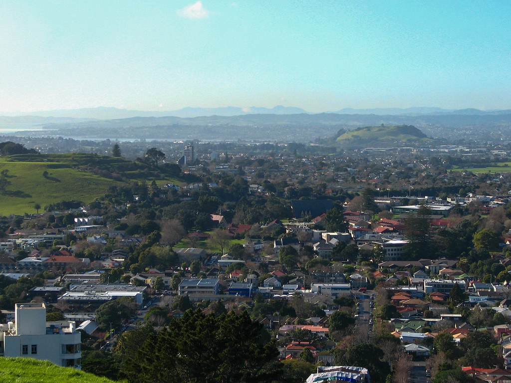 View of the city from the top of Mt. Eden. You can see two of the other extinct volcanoes.