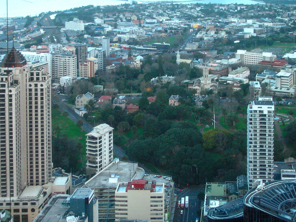 Auckland, as viewed from the top of the Sky Tower. The large green area in the center of the photo is Albert Park.