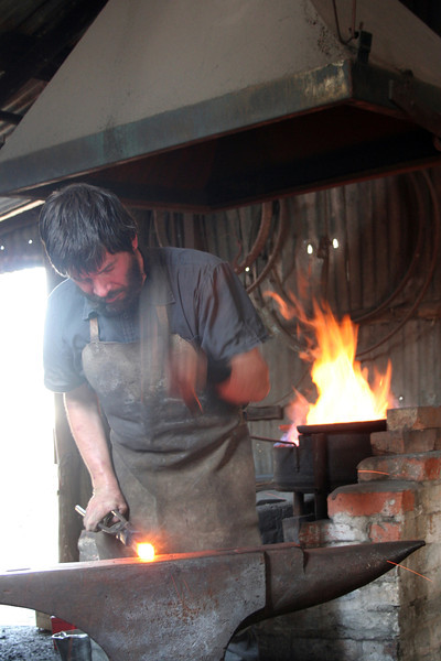 27 October 2013: Australiana Pioneer Village, Wilberforce, New South Wales. Smithy at work.