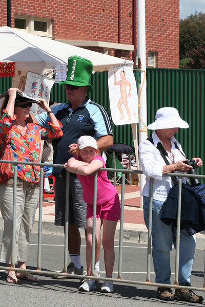 Girl in pink, Dad in green, Mum in newspaper. The Running of the Sheep, Boorowa, 5 October 2008.