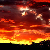 Aerial inferno above the western horizon at sunset, Reids Flat, New South Wales.