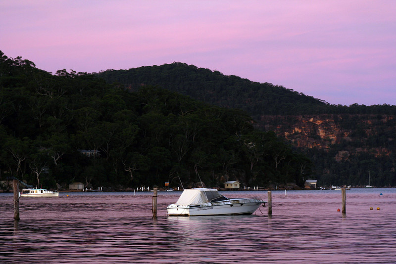 Dangar Island (dark slope at middle left), and Little Wobby (sandstone outcrop and mountain at rear), viewed from Brooklyn ferry wharf, New South Wales, Australia.