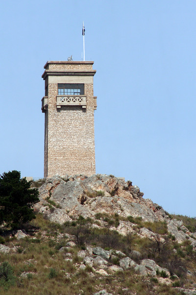 The Goulburn War Memorial, situated at the summit of Rocky Hill, was funded by public subscription and opened in 1925. It commemorates the residents of Goulburn who served in World War I. At night a rotating-beam searchlight operates from the rooftop. The tower's design is reminiscent of the pylons of the Sydney Harbour Bridge, which was under construction at about the same time.