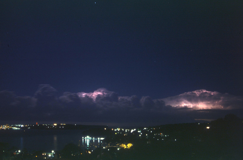 Summer evening storms over the Pacific, off the coast of Sydney. View towards North Head and Manly from Muston Street, Mosman.