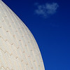 Sydney Opera House Concert Hall roof, cloud and aircraft contrail.
