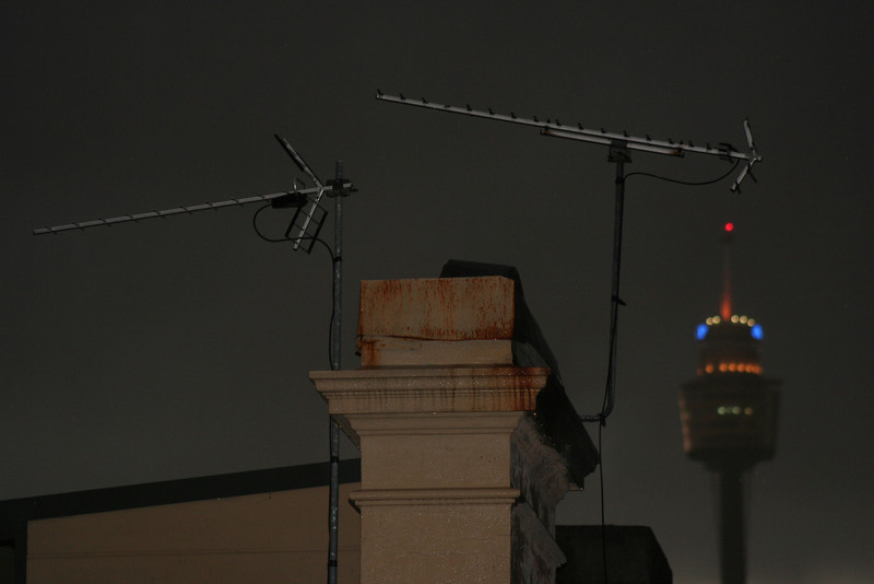 Potts Point rooftop scene during a late Autumn thunderstorm, with Sydney Tower in the distance.
