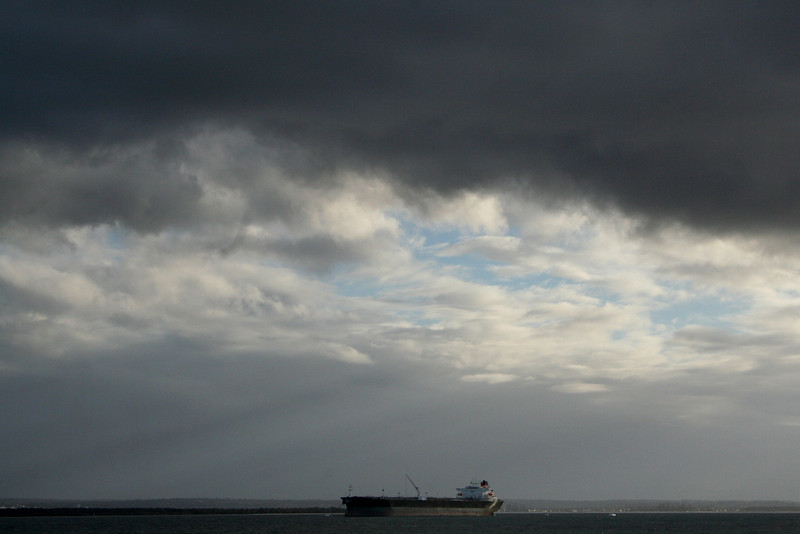 Grey skies and crepuscular rays over Botany Bay.