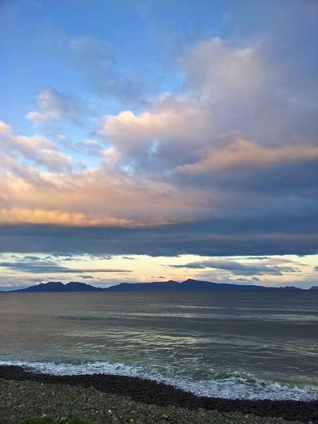 27 July 2015: Sunset on Great Oyster Bay;view of the Freycinet Peninsula from Schouten Beach, Swansea, Tasmania.