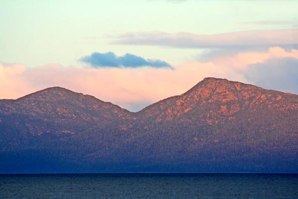 27 July 2015: Red sunset on the Freycinet Peninsula; view across Great Oyster Bay from Schouten Beach, Swansea, Tasmania.