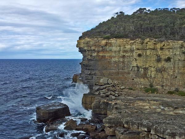 24 July 2015: Sea cliff near the Devil's Kitchen, near Eaglehawk Neck, on the Tasman Peninsula, Tasmania.
