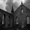 Ominous stormclouds gather above the abandoned church at the former penal colony of Port Arthur.