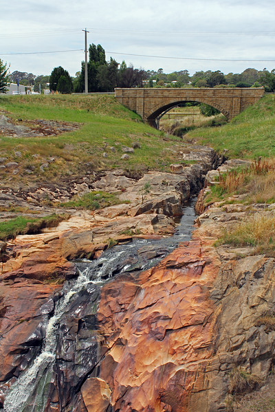 Spring Creek, Beechworth, at Newton Falls, with Newton Bridge in the background. Gold was discovered about a hundred metres upstream of the bridge on 3 August, 1852.