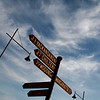 2 January 2012 @ Beechworth, Victoria: Late afternoon skyscape with street sign, streetlights and aircraft contrail.