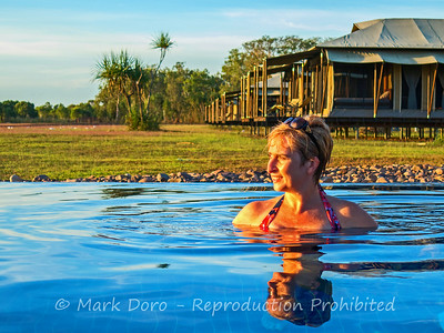 In the pool at Wildman Wilderness Lodge watching the sunset, Mary River, Northern Territory
