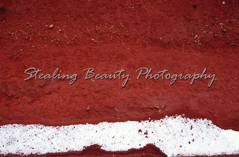 Snow on red earth