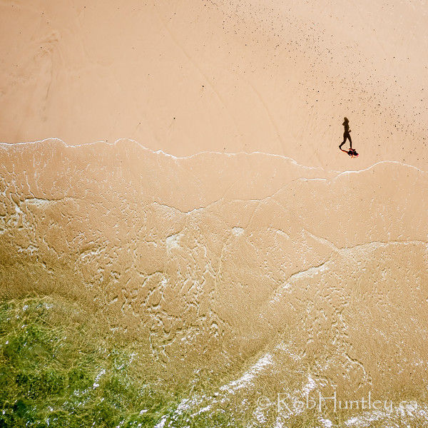 Jogger on Tallow Beach. Byron Bay, Australia.