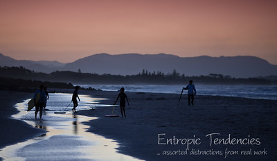 Byron Bay - surfers on the beach at sunset Date: 11 August 2009 © Copyright 2009 Barrie Spence