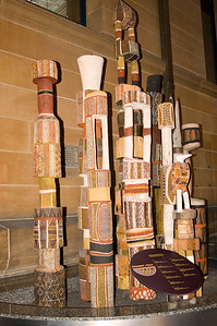 Pukumani Poles Australian Museum Sydney, NSW Australia - 20 Jun 2006  The Tiwi people from the Northern Territory mourn their dead for many months. During this period, they carve a Pukumani pole to represent the dead person and to assist the spirit into the next life. The height of the pole is directly related to the person's status in the community and the design symbolises the family totem. The raising of the pole signals the end of the mourning period.
