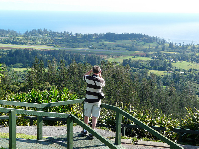 Sunday - View of Norfolk Island Airport from top of Mount Pitt - there is an aircraft taking off directly in front of where the gentleman is aiming his camera.