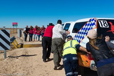 Push the police car over South Australia/ Queensland border