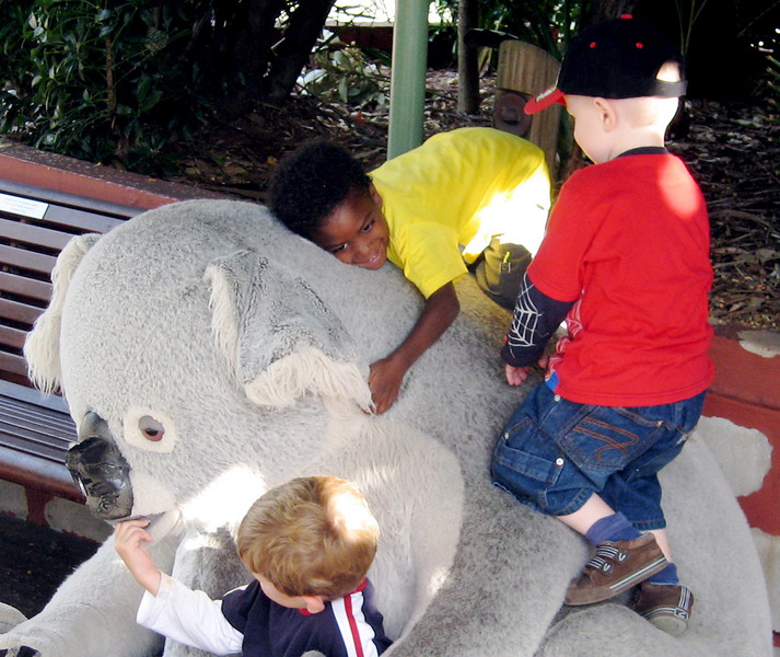 Kids climb the plush Koala bear at Taronga Zoo