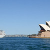 Cruise vessel passes the Opera House as it departs Sydney Harbor.