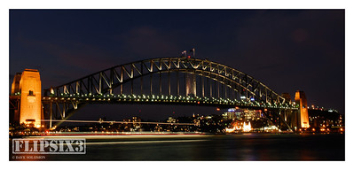 Harbour Bridge by night, and the Manly Ferry coming in.