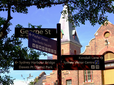 Street signs guide visitors around the Rocks area in Sydney