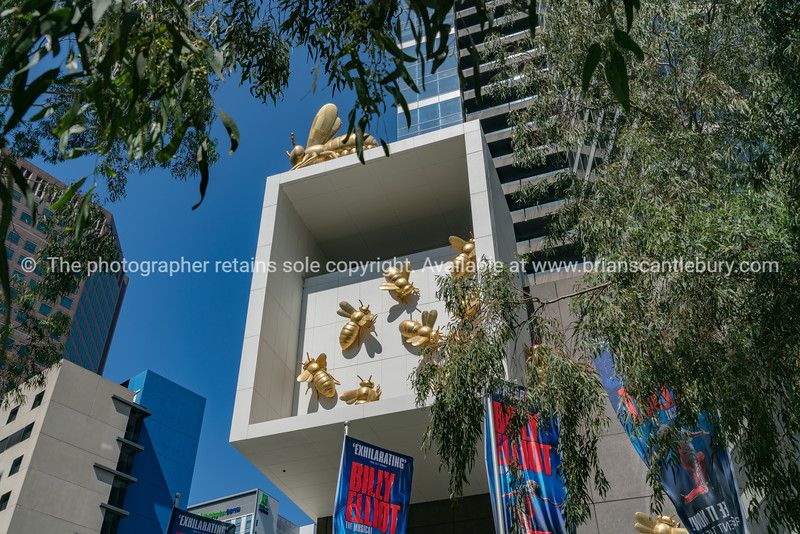 Modern architectural design and features with decorative golden colored bees.