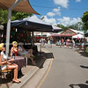 Eumundi Markets, tourists photograph a couple of paper-mache models.