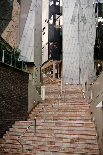 Steps in Melbourne leading between modern buildings.