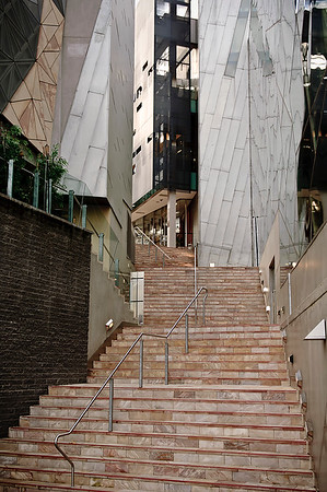 Steps in Melbourne leading between modern buildings.