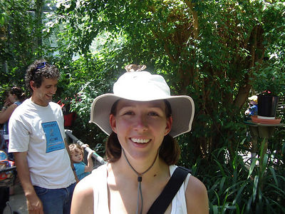 Tanya with butterflies on her head at the Melbourne Zoo.